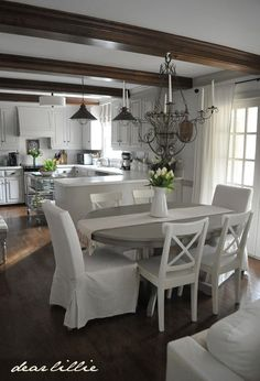 Gray kitchen table w/ White chairs. Adding some Spring Colors In our Kitchen and Family Room by Dear Lillie