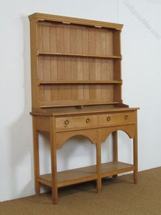 The dresser An Arts & Crafts Cotswold School cottage dresser made by Kenneth Desmond Lampard in the mid C20th. Kenneth Desmond Lampard (born 1926) had been a pupil of Edward Barnsley in the late 1940's. The dresser is constructed in solid well figured quarter sawn oak with a light dry finish.