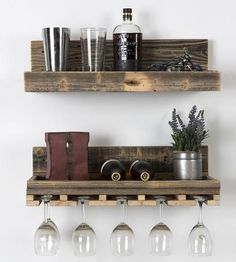 This pair of floating shelves is built from reclaimed wood to hold wine bottles and glasses, cups and coasters on the wall.