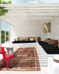 boho... black cushions with interesting throw pillows