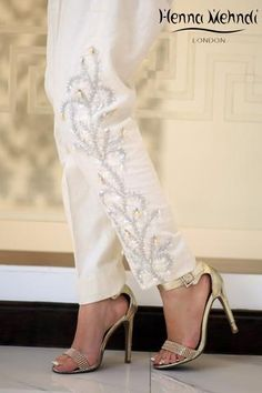 Cream Karandi trousers with embroidery on one leg with embellishment. Available in trousers, cigarette trousers or boot cut trousers. Can also be ordered in Kurti With Jeans, Plus Sise, Pakistani Bridal Dresses, Pants For Women, Clothes For Women, Embroidered Clothes, Mode Hijab, Indian Designer Wear, Indian Wear