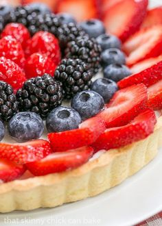 Summer Fruit Tart | A buttery tart shell filled with lemon kissed cheesecake filling and topped with gorgeous berries @lizzydo