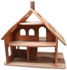 wooden dollhouse, dollhouse for Christmas. Dad made me a dollhouse for christmas when I was seven years old. It didn't look exactly like this but was made of plywood . We never got it painted or decorated, but I played with it everyday with what furniture I had.