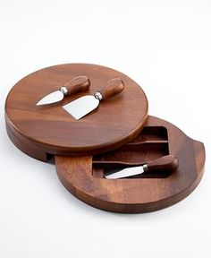 Very clever, this acacia wood cheese board from The Cellar features a hidden layer that swivels out and stores knives for slicing and spreading. A must for every wine and cheese party. | Wood/stainles