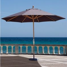 "This 11' Premium ""Classic TEAK"" Market Umbrella made with High grade Teak Wood pole features a reliable Stainless Steel cable Crank lift system.  Quality umbrella for $499.00 sale price.  Product ID : GAL-587tk #PatioUmbrella"