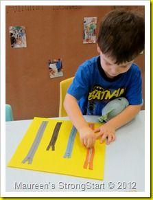 Zipper practice. The teacher hot glued zippers onto a board.