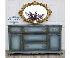 Chalk painted buffet using Dixie Belle Paint in stormy seas, vintage duck egg, and driftwood, black glaze, gold guilding wax Facebook.com/brushedbybrandy