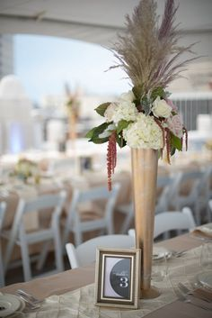 These tall gold centerpieces are perfect for long reception tables!