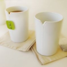 """I love these """"zipper"""" mugs that have a spot to hang your tea bag. Tea drinkers 4 lyfe!"""