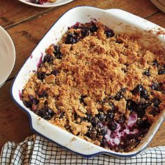 Ripe, fresh blueberries are perfect for this dish, though frozen berries will also work. But keep them frozen, and bake the crisp 10 or 15 minutes longer as needed. Thawed berries are too fragile to toss and give off lots of liquid. Serve warm or at room temperature with low-fat vanilla ice cream--a 1/4-cup scoop adds only about 55 calories a serving.