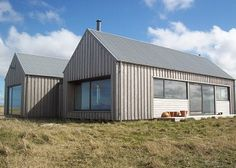 Dualchas Architects - Ardivachar Larch cladding, steel roof.  Much prefer vertical cladding.