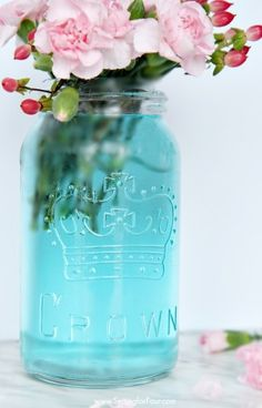 Such a clever DIY tip! This is the quickest, easiest way (ever!) to tint mason jars blue! I can't believe how simple it is to get that perfect vintage blue mason jar color without any messy painting! www.settingforfour.com