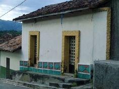 Doors to a house in a village in El Salvador.