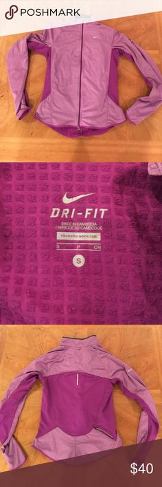 Nike dri-fit running jacket Heathered purple, thumb holes, reflector zipper, key pocket, inside has fleece, scalloped, longer in back, and fitted flattering look. Some minor pilling on the inside, and the dri-fit logo on bottom is a little cracked but not noticeable. Nike Jackets & Coats
