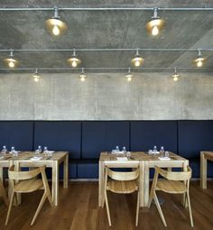 Nottingdale Cafe by Found Associates-Solid oak with a natural finish was selected for the main floors and stairs to provide a warm contrast to the concrete and black walls.