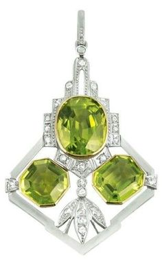 Art Deco Bi-colour Gold, Peridot and Diamond Pendant. 14 kt. yellow and white gold, 3 peridots ap. 11.50 cts., rose-cut diamonds, circa 1930.