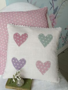 "pretty vintage linen 14"" square cushion with ecru ric arc trim. 4 polka dot hearts applique in pinks and duck. envelope closure complete with feather pad. free UK delivery."