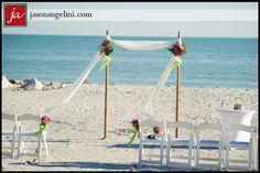 bamboo & chiffon beach wedding arch