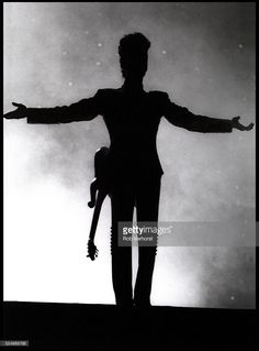 Prince, in silhouette, performs on stage on the Diamonds & Pearls Tour, Ahoy, Rotterdam, Netherlands, 27th May 1992.