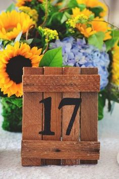 Sunflower Wedding Table Numbers   A Yellow and Blue Rustic Florida Wedding via TheELD.com   Jason Mize Photography