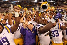 The LSU football team rolled for 448 yards of total offense and overcame a few of its own mistakes to beat No. 20 TCU, and remain perfect in three trips to Arlington. Lsu Tigers Football, Football Team, New Orleans Saints, Louisiana, Mickey Mouse, August 31, Disney Characters, Purple, Mistakes