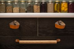 """12"""" leather and white oak wood handle perfect for mounting horizontally on wide drawer fronts or vertically on tall cabinet doors."""