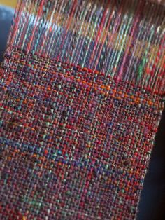 Variegated homespun, handwoven on a simple two-shaft loom. I love this!