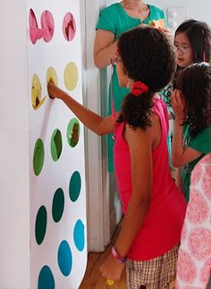 Seems like a fun idea for monthly summer activities. Have a kid punch the hole, pull out the written activity.