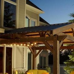 Complete the look of your Lodge II wood pergola, while gaining extra protection from the sun and rain by adding this forest green metal roof. This easy-to-install roof gives your pergola a full roof closure and protection. Pergola Carport, Pergola Swing, Backyard Pergola, Pergola Shade, Patio Roof, Diy Patio, Pergola Plans, Pergola Ideas, Patio Ideas