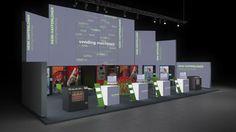 118 Automatenstationen Heini Haffenloher    Auffälliger Messestand für einen Hersteller von Verkaufsautomaten.   Die zu einem Halbkreis montierten Leuchtwände unterschiedlicher Höhe schaffen...