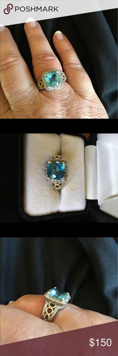 Blue Topaz Sterling Silver/ Gold size 8 ring This ring is a cushion style blue topaz with small diamonds surrounding it. It is sterling silver with 14kt gold filigree design on the sides. Size 8 and could be resized. Jewelry Rings