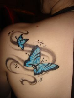 I'm not a big fan of butterfly tattoos, but I do really like the colors, and the swirls are really pretty ^_^