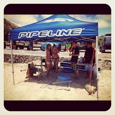 Hawaii surf team member Ikaika Freitas of Oahu having a fun beach day with some friends under the PIPELINE tent.