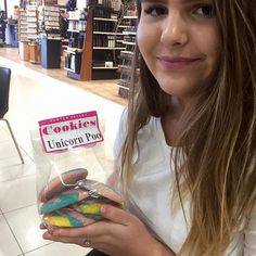 On our way to Melbourne I found these cookies and had to buy them. My daughter is holding them for the pic  #unicornpoopcookies