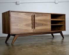 The BlackGold is a mid century modern TV console