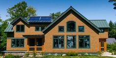 timber frame home in maine with solar panels