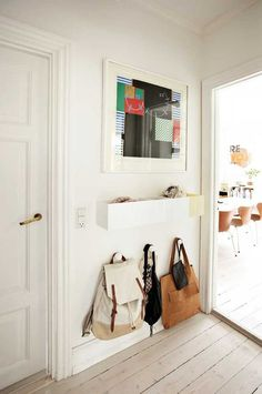 Here's a little inspiration from small-space entryways, ways to make the space right next to your front door into a little workhorse that will keep the rest of your home pleasantly