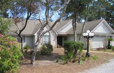 """249 Boca Shores Drive #PanamaCityBeach, #FL 32408  This 3 bedroom/2 bath home with a secluded double lot is located on a cul-de-sac in a desirable quiet neighborhood off North Lagoon Drive near local Navy Base. Located in a sought-after school district. This house has an open spacious floor plan, a large fire place, vaulted ceilings, bonus room, plenty of storage, and a """"one of a kind"""" lot for your heart's desire...pool, workshop, RV parking. #Florida #RealEstate"""