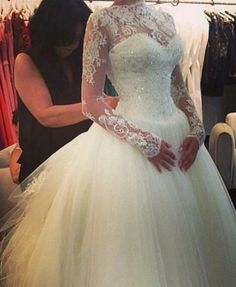 This long sleeve wedding gown is perfect for a modest Church wedding. The illusion neckline and beaded lace add to the design. Brides searching for more traditional or modest #weddingdresses will love this design. Custom dresses and #replicas of couture design for less can be made by our American firm. We can recreate any dress from any picture at www.dariuscordell.com/?utm_content=bufferfbe9a&utm_medium=social&utm_source=pinterest.com&utm_campaign=buffer