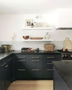 Dark kitchen base cabinets with dark worktop