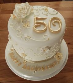 50th golden wedding anniversary cake with sugar flowers and royal iced piped details