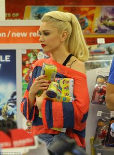 Toys for boys! Gwen Stefani looks stylish as she treats her three sons to a shopping spree at Toys R Us | Daily Mail Online