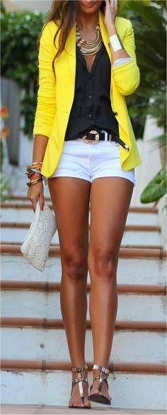 Yellow blazer, black shirt, sandals, white shorts and purse