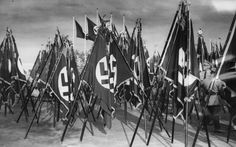 Hundreds of Nazi flags of the German political leaders are pictured leaning against each other, during a parade during the Reichsparteitag (Empire Party Meeting) in Nuremberg, Germany, September 13, 1935.