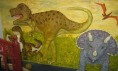 "Brightening up a school corridor with an amazing dinosaur mural using paper mache to make the horns of the Triceratops, the jaws and the T. rex and the claws of the ""raptors"" stand out in a 3-D effect."
