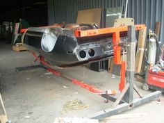 Autobody Rotisserie by POCKER -- Homemade autobody rotisserie fabricated from structural metal tubing. Powered by ram jacks. http://www.homemadetools.net/homemade-autobody-rotisserie