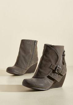 Considering you're rocking the accent zipper, ornamental buckle, and faux-stacked wedge on this Blowfish bootie, you must be going somewhere posh! Can we come? We just know there are stylish times to be had where these dark grey, vegan faux-leather foldover boots hang out!