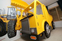 This Dump Truck Bed looks fantastic and you can make it yourself.  It even comes with a Front End Loader Bookshelf!