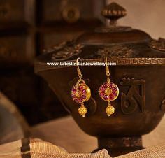 Antique gold ruby hoop earrings featuring lush-red fiery Burmese rubies radiating a royal charisma unlike any other gem. These ear. Jewelry Design Earrings, Gold Earrings Designs, Ear Jewelry, Jewellery Designs, Jewellery Showroom, Jewellery Sketches, Diy Jewellery, Jewellery Storage, Gold Wedding Jewelry