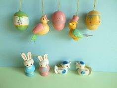 This listing is for 2 bunnies, 4 birds and 3 eggs. They are hand painted in white and pastel colors and make a lovely decoration for your home this spring. Traditionally bare-branched twigs are cut from the garden and put in water in a vase, then decorated with small Easter eggs and other spring ornaments. Soon the branches will start to grow leaves and blossom and together with the cheerfully coloured eggs that were made in the dark winter months make a wonderful decoration piece.  Please…